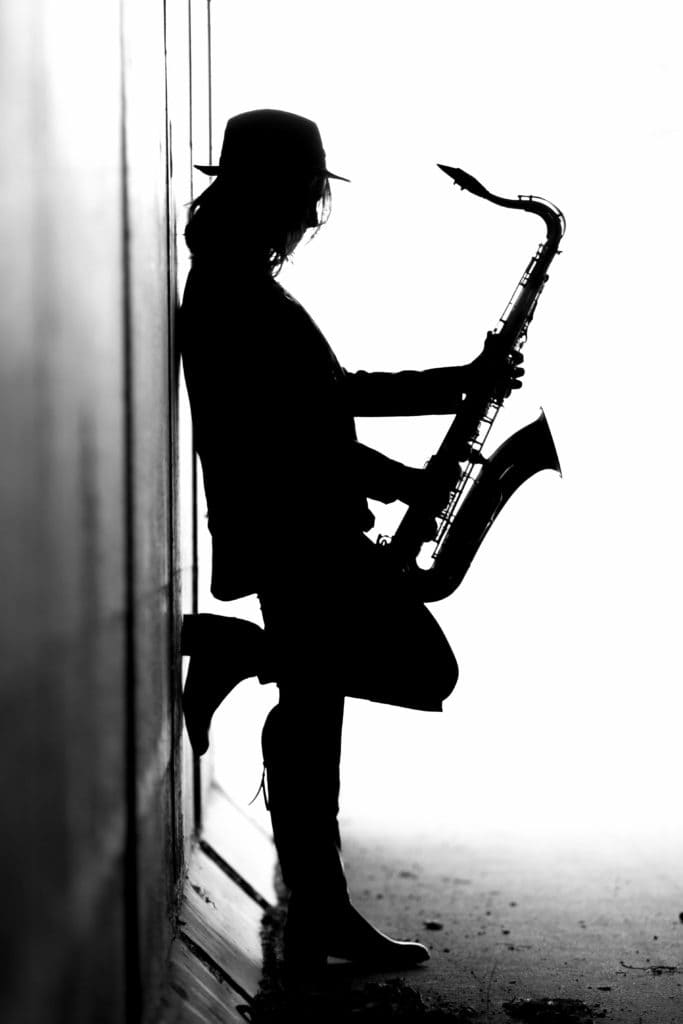 holding the saxophone